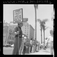Robert O. Hahn of Orange Grove Friends Meeting, holding silent peace vigil in Pasadena, Calif., 1972