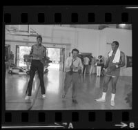 """Peter Falk with Los Angeles Lakers Jim McMillian and Leroy Ellis during filming of """"Colombo"""" television series, 1972"""