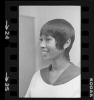 Woman modeling African American hairstyle, 1972