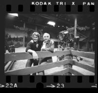 """Actors Lorne Greene and Michael Landon on the set of the television series """"Bonanza,"""" 1972"""