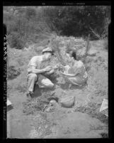 Jack and Hazel Speirs examine Indian skull uncovered in old Indian burial ground at Lake Sherwood, Calif., 1949