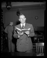 "Attorney Martin McManus reading ""lewd"" book ""Memoirs of Hecate County"" by Edmund Wilson"