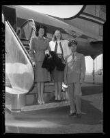 Three members of the California Tip Toppers club for tall men and women arriving for first national convention in Los Angeles, Calif., 1947