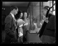 Henry Trubner, Los Angeles County Art Museum curator of Oriental art viewing exhibit with Pauline Wong and Hung-Pin Kwan, circa 1947