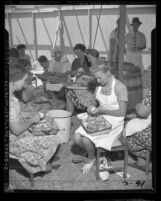 Women peeling potatoes in tent at camp for Jehovah's Witnesses gathering in Los Angeles, Calif., 1947