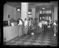 "Veterans waiting in line at Bank of America to cash bonds during G.I. bond ""gold rush"" in Los Angeles, Calif., 1947"