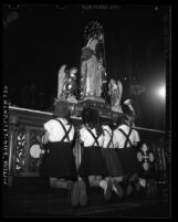 "Girls praying before ""Our Lady of the Cape of the Holy Rosary"" statue on loan from Quebec to St. Joseph's Catholic Church in Los Angeles, Calif., 1947"