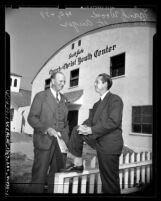 Frank Wood and Reverend Everett Auger outside of South Gate Church of Christ Youth Center, Calif., 1947
