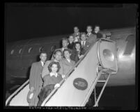 Hollywood Committee for the First Amendment members disembarking plane in Los Angeles, Calif., 1947