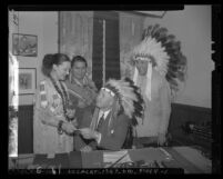 Prince Tha Tha Quha, Tom Youngplant and Chief Sunrise with Board of Supervisor Raymond V. Darby in headdress Los Angeles, Calif., circa 1947