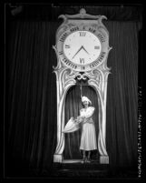 Model Tilli Dieterle making entrance under clock during California Fashion Show in Los Angeles, Calif., 1947