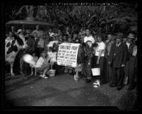 Crowd surrounding 4-H club members milking cow in Pershing Square during California Milk Ship campaign, Los Angeles, Calif., 1948