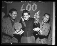 David Yee, Alan Young and Frank Tang joking around with firecrackers during Chinese New Year in Los Angeles, 1948