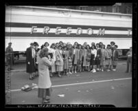 Susan B. Anthony Club members having picture taken in front of Freedom Train in Los Angeles, circa 1948