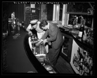 Kenneth Hahn, Los Angeles City Councilman inspecting bar at nightclub in Los Angeles, Calif., circa 1948
