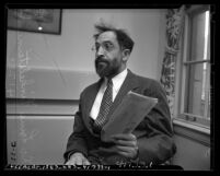 Dr. Louis Finkelstein, president of the Jewish Theological Seminary of America, 1/2 length portrait, 1948