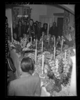 Father Robert Deegan blessing table of food on St. Joseph's Day in Los Angeles, Calif., 1948