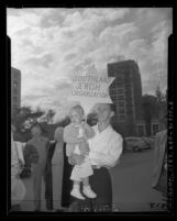 "Man with toddler holding Star of David sign reading ""Southland Jewish Organization"" in Los Angeles, Calif., 1948"