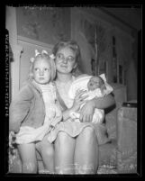 Mrs. William Martin with daughter Rinda Lee Martin and holding baby she bought from black market sources in Los Angeles, Calif., 1948