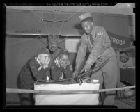 Boy Scout showing two Cub Scouts model plane at Scout-O-Rama event in Los Angeles, Calif., 1948