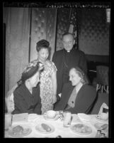 Catholic Woman's Club members Mrs. J. Selby Spurck, Elizabeth Guttenberg, Mrs. Yi-Seng Kiang and Reverend Joseph T. McGucken Los Angeles, Calif., 1948