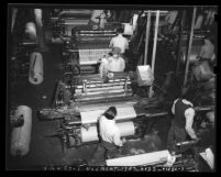 Inmates operating mechanical looms at San Quentin Prison's industrial program, Calif., circa 1948