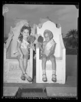 Five-year olds Margaret A. Wall and Bobby Schwartz named King and Queen of wading pool at State Street Playground in Los Angeles, Calif., 1948