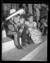 Three Mexican American children in costumes at Re-Enactment of 1769 Portola expedition Los Angeles, Calif., 1948