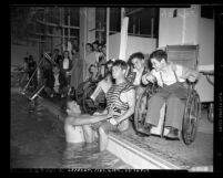 Comedian Buster Crabbe entertaining crippled children during Buster Crabbe's Aqua Parade at Children's Hospital in Los Angeles, Calif., 1948