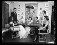 Las Damas Pan Americanas club members in evening clothes, seated at table in Los Angeles, Calif., 1948