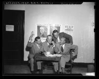 Stephen L. Wells, E. George Luckey, Frank Scriven and Virgil Backer at Democratic headquarters in Los Angeles, Calif., 1948