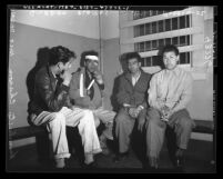 Four Mexican American gang members in jail after fight in Los Angeles, Calif., circa 1948