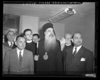 Patriarch Athenagoras, Archbishop of Greek Orthodox Church, with group of men in Los Angeles, Calif., 1948