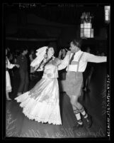 Daphne Alley in Mexican costume and R. Allen Pelton in Bavarian costume dancing at Folk Dance Festival in Los Angeles, Calif., 1949