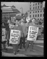 "CIO Political Action Committee members with Stalin masks and signs reading ""Free 10 Million Workers in Soviet Slave Labor Camps"" protesting in Los Angeles, 1949"