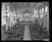 Interior of St. Paul's Catholic Church during Boy Scouts service awards ceremony, Los Angeles, 1949