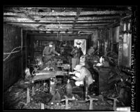 Police inspecting burned out interior of bar after explosion in Los Angeles, Calif., 1949