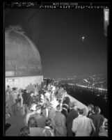 Crowd watching eclipse of the moon on balcony of Griffith Observatory, Calif., 1949