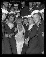 Actress Betty Hutton with Canadian sailors on board HMCS Ontario, 1949