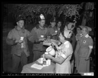 Nurses serving firemen donuts after fire at Hollywood Park racetrack, Calif., 1949