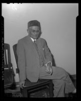 Curuppumullage Jinarajadasa, seated portrait, 1949