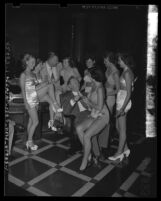 L. E. Timberlake and Ernest Debs buying Westchester Fair tickets of bathing beauties, Los Angeles, Calif., 1949