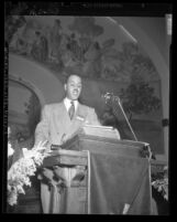 Roy Wilkins at podium, speaking at 10th Annual Convention of the NAACP in Los Angeles, Calif., 1949,