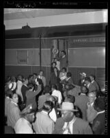 Ralph J. Bunche and family being greeted upon arrival at Los Angeles Union Station, 1949
