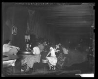 Prostitutes at a bar on Main Street in Los Angeles, Calif., circa 1949