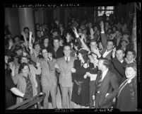 Reverend Joseph Jeffers and wife Zella of Kingdom Temple, with followers after being released on bail in Los Angeles, Calif., 1939