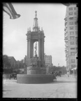 Victory Fountain with surrounding buildings and automobiles in Long Beach, 1926