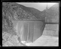 View from top rim looking at the backside of completed Pacoima Dam before it was filled with water, Calif., circa 1928