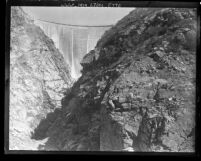 View from canyon floor looking up at completed Pacoima Dam, Calif., circa 1928