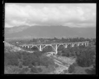 Colorado Street Bridge with San Gabriel mountains in background, Pasadena, circa 1920
